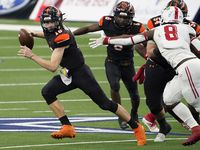 Aledo quarterback Brayden Fowler-Nicolosi (16) gets past Crosby defensive lineman Jeremiah Isaac (8) during the first half of the Class 5A Division II state football championship game at AT&T Stadium on Friday, Jan. 15, 2021, in Arlington.