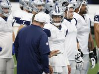 Dallas Cowboys quarterback Dak Prescott (4) talks with Dallas Cowboys head coach Mike McCarthy in practice on Cowboys Night during training camp at AT&T Stadium in Arlington, Texas on Sunday, August 30, 2020.