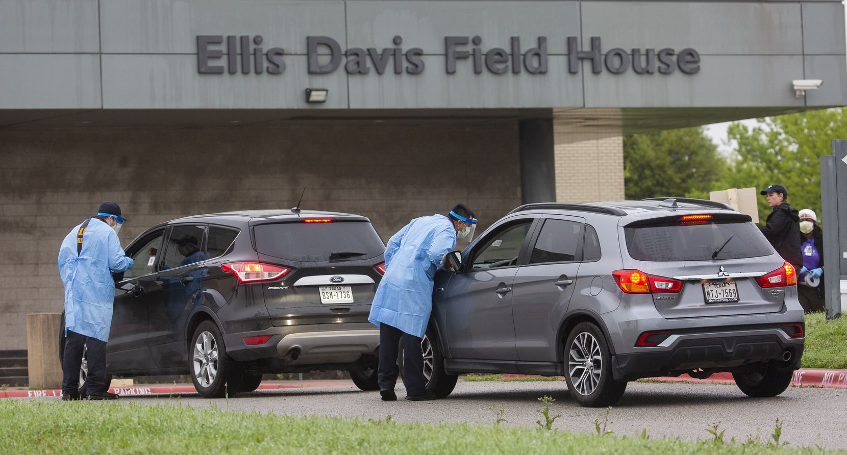 Medical professionals screen patients before letting them into a testing site at Ellis Davis Field House, 9191. S. Polk Street, near Interstate 20 in Red Bird on March 22, 2020 in Dallas. To be tested, individuals must have a fever of 99.6 degrees or above and be either 65 or older, a first responder, a health care worker or a DART bus driver.