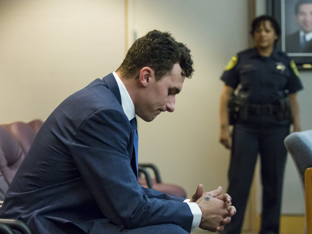 Former Texas A&M and Cleveland Browns quarterback Johnny Manziel sits at the back of the courtroom while his defense attorneys confer with the prosecution after he appeared before Judge Roberto Cañas at the Frank Crowley Courts Building on Thursday, May 5, 2016, in Dallas. (Smiley N. Pool/The Dallas Morning News)