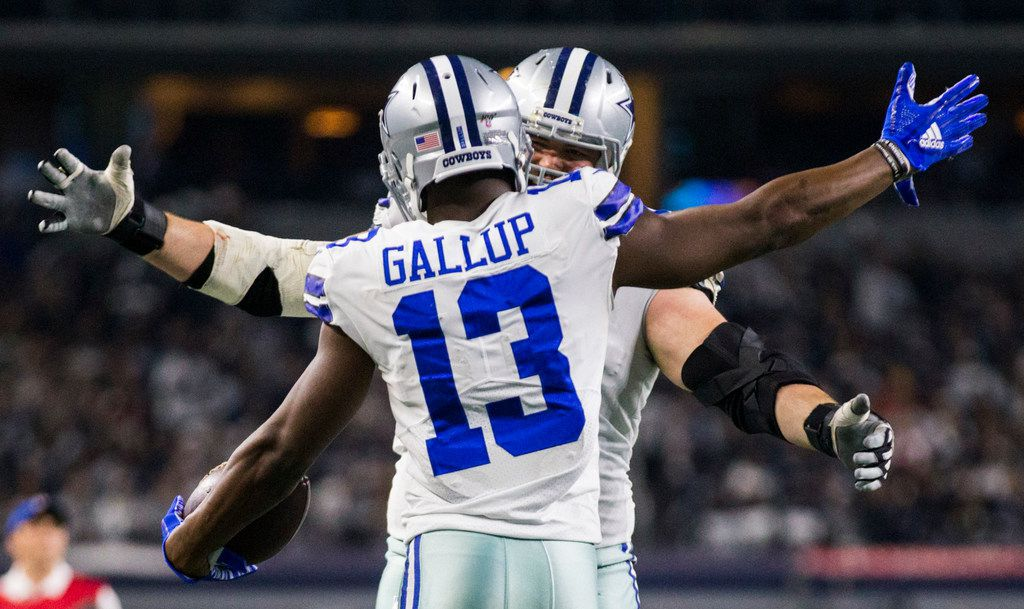Dallas Cowboys wide receiver Michael Gallup (13) celebrates a touchdown with offensive guard Zack Martin (70) during the fourth quarter of an NFL game between the Dallas Cowboys and the Washington Redskins on Sunday, December 29, 2019 at AT&T Stadium in Arlington, Texas. (Ashley Landis/The Dallas Morning News)