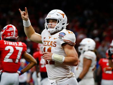 Texas quarterback Sam Ehlinger (11) celebrates his second touchdown carry in the first half of the Longhorns' Sugar Bowl win against Georgia in New Orleans on Jan. 1, 2019.. (AP Photo/Butch Dill, File)