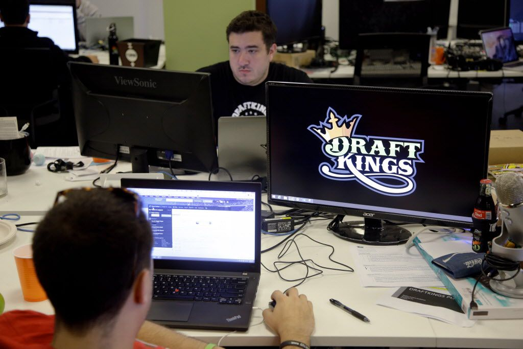 Len Don Diego, marketing manager for content at DraftKings, a daily fantasy sports company, works at his station at the company's offices in Boston. DraftKings, one of two leading companies in the field, has sued over Texas Attorney General Ken Paxton's opinion that daily fantasy games are illegal under Texas gambling law.