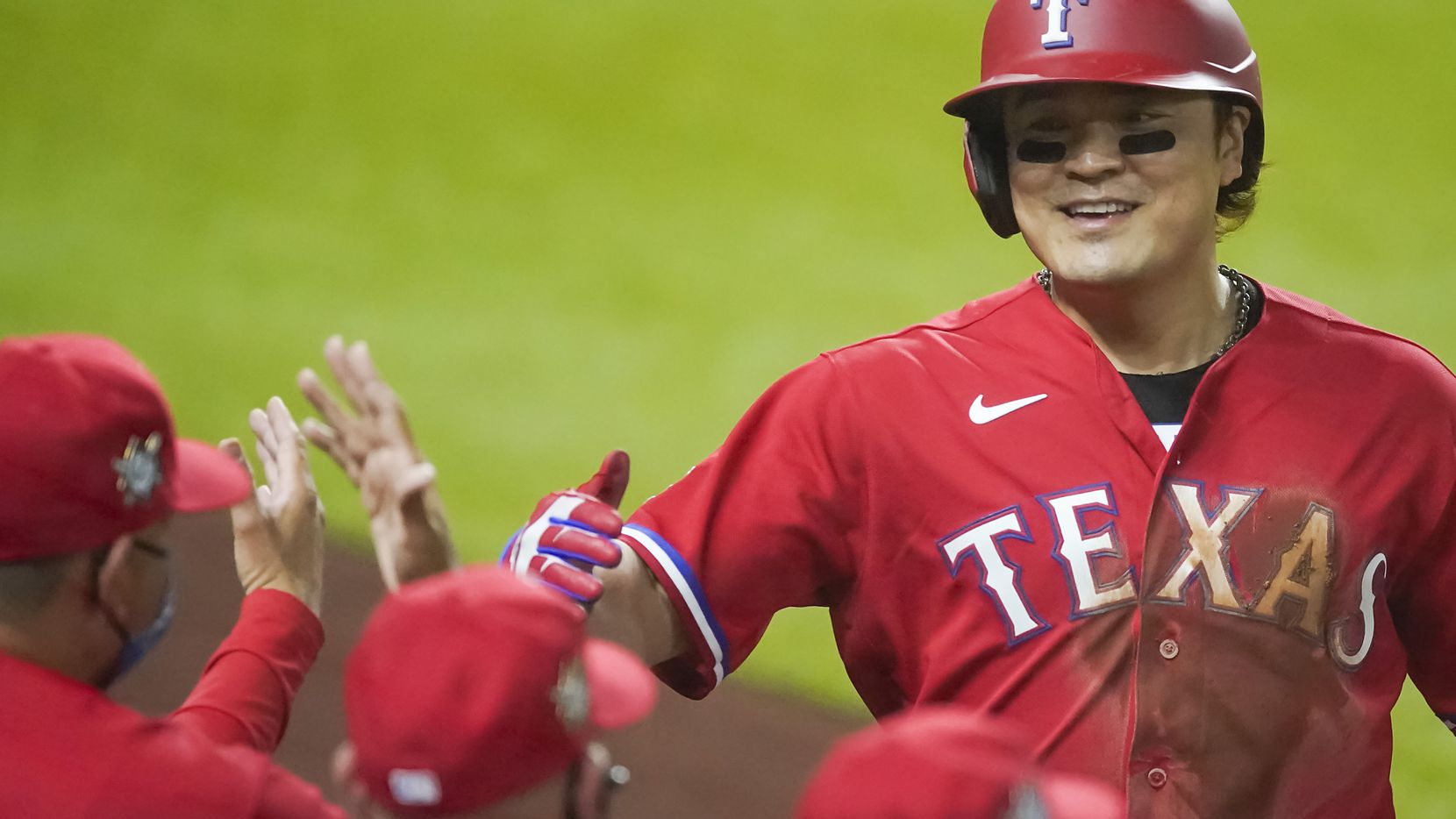 Texas Rangers designated hitter Shin-Soo Choo celebrates after scoring during the third inning against the Los Angeles Dodgers at Globe Life Field on Friday, Aug. 28, 2020. (Smiley N. Pool/The Dallas Morning News)