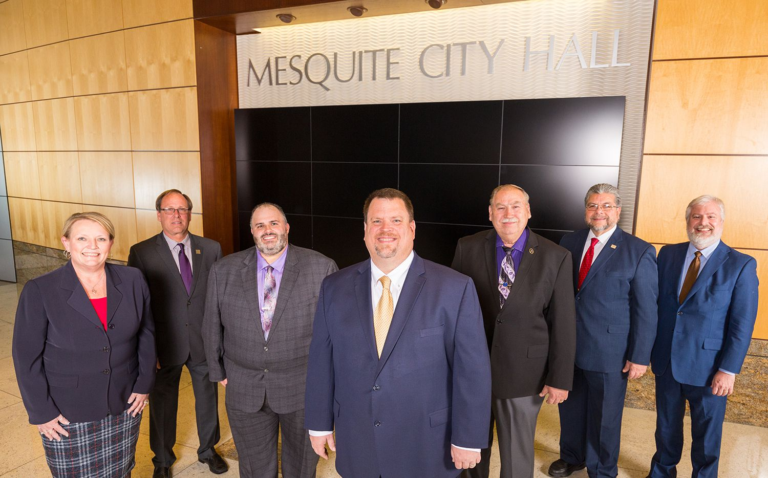 Mesquite's current city council stands inside City Hall. Members are Sherry Wisdom (District 1), Tandy Boroughs (District 4), Kenny Green (District 2), Mayor Bruce Archer, B.W. Smith (District 5), Daniel Aleman (District 5) and Robert Miklos (District 3) (Courtesy city of Mesquite).
