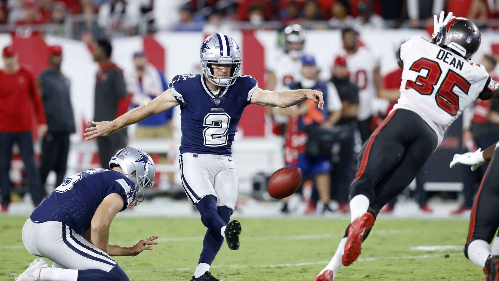 Dallas Cowboys place kicker Greg Zuerlein (2) kicks the go-ahead field late in the fourth quarter as Tampa Bay Buccaneers cornerback Jamel Dean (35) makes a diving block attempt at Raymond James Stadium in Tampa, Florida, Thursday, September 9, 2021.