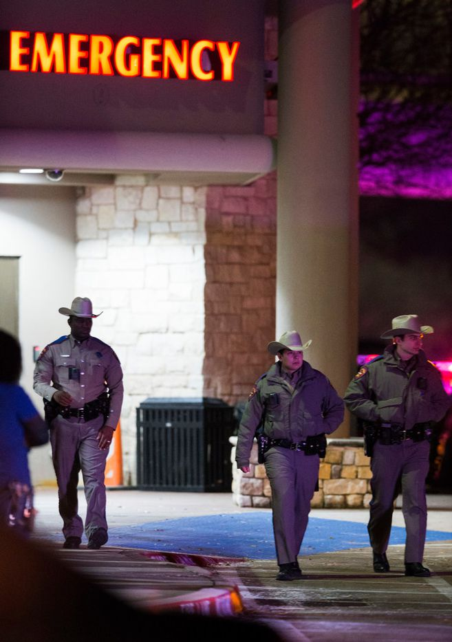 Law enforcement officers leave the emergency room at Medical City Plano hospital in Plano, Texas after a Richardson, Texas police officer was shot and killed on Wednesday, February 7, 2018, at an apartment complex in Richardson.
