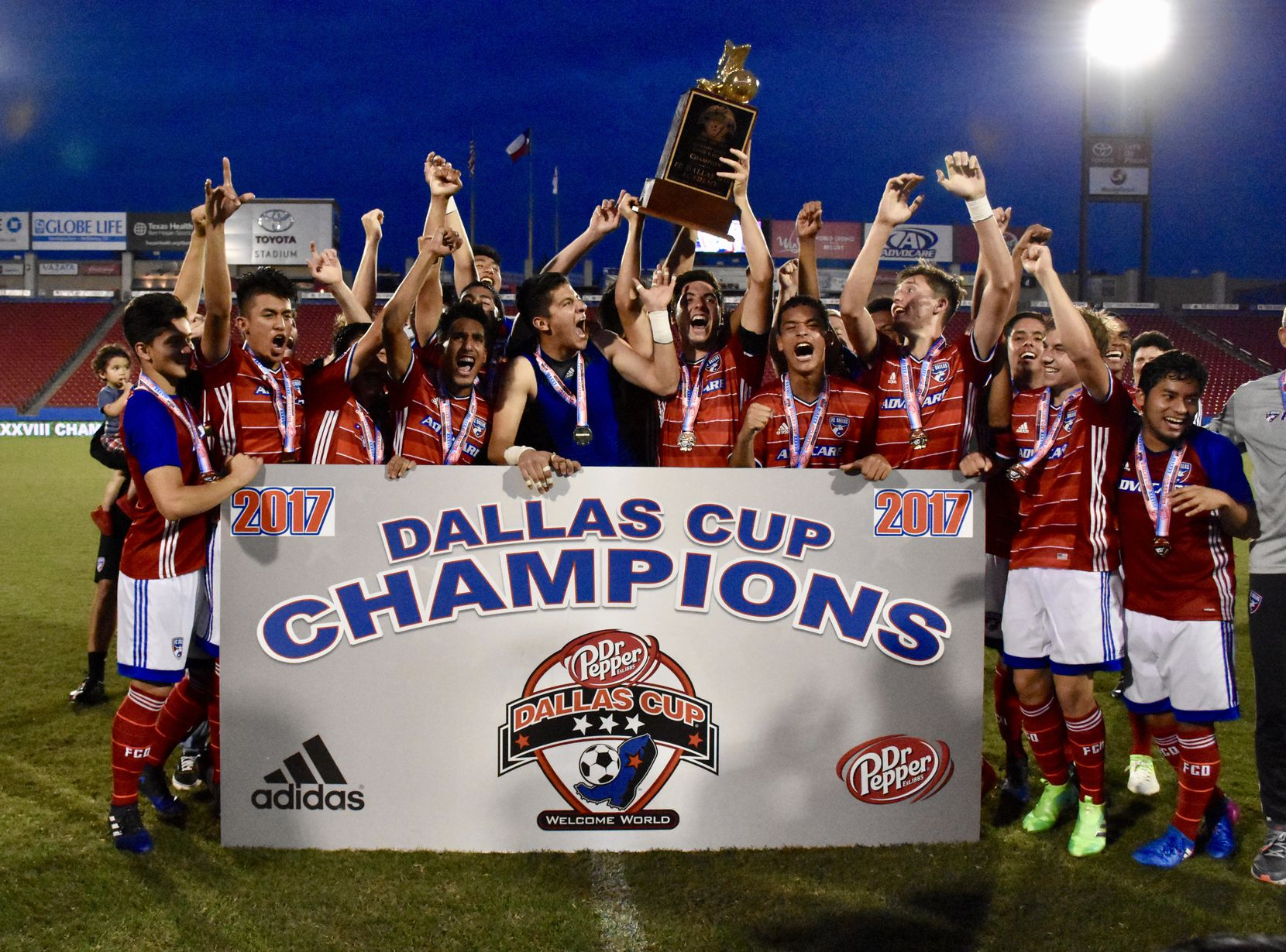 FC Dallas hoists the 2017 Dallas Cup Super Group trophy.  They were the 2nd domestic side to win Dallas Cup's elite Super Group.