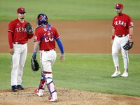 Texas Rangers starting pitcher Kohei Arihara (left)   waits for manager Chris Woodward to pull him from the game in the third inning against the Boston Red Sox at Globe Life Field in Arlington, Texas, Friday, April 30, 2021. (Tom Fox/The Dallas Morning News)