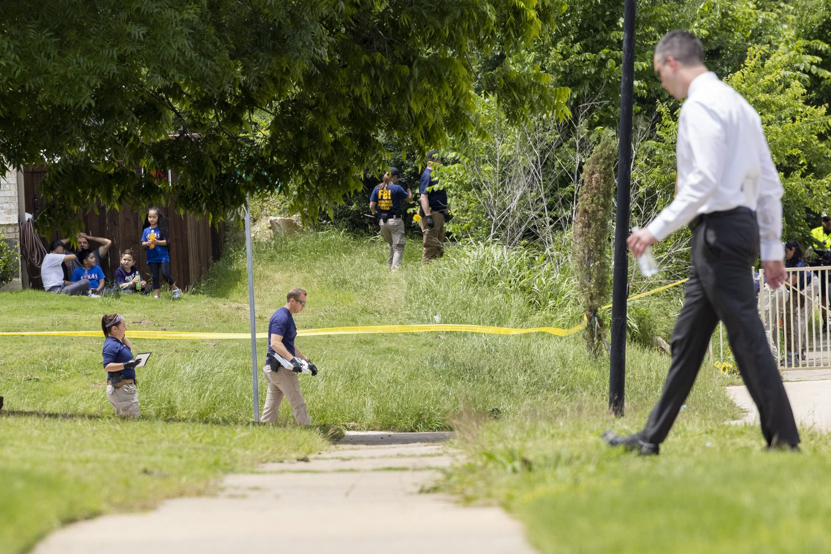 Authorities combed over the area near where the boy's body was found.