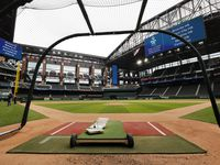 FILE - Rangers players have been using a batting cage at the newly completed Globe Life Field in Arlington, pictured here on Wednesday, May 20 2020.