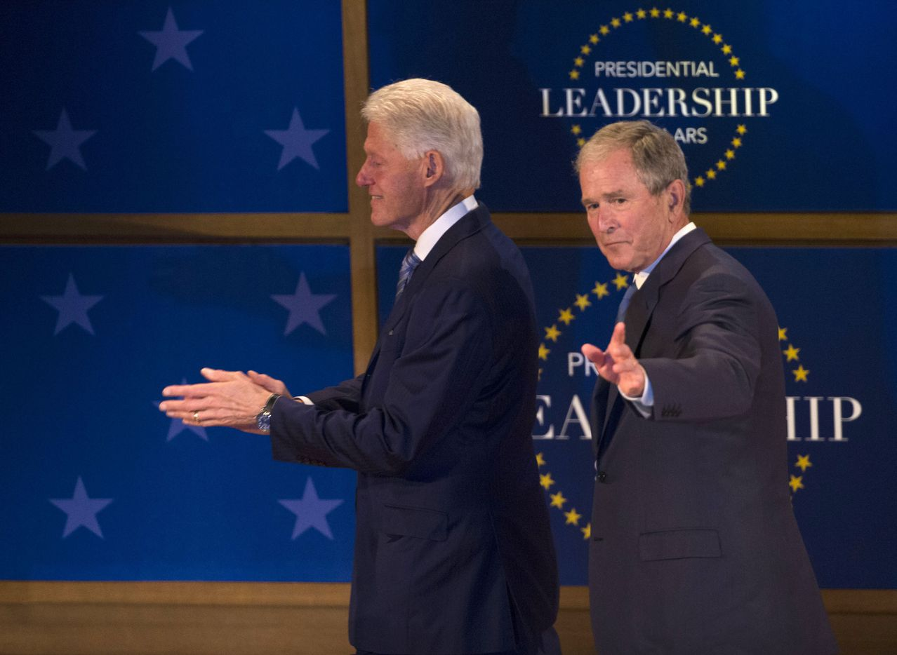 Former Presidents George W. Bush and Bill Clinton wave during the Presidential Leadership Scholars Graduation at the George W. Bush Presidential Center in Dallas, Texas, Thursday, July 13, 2017.