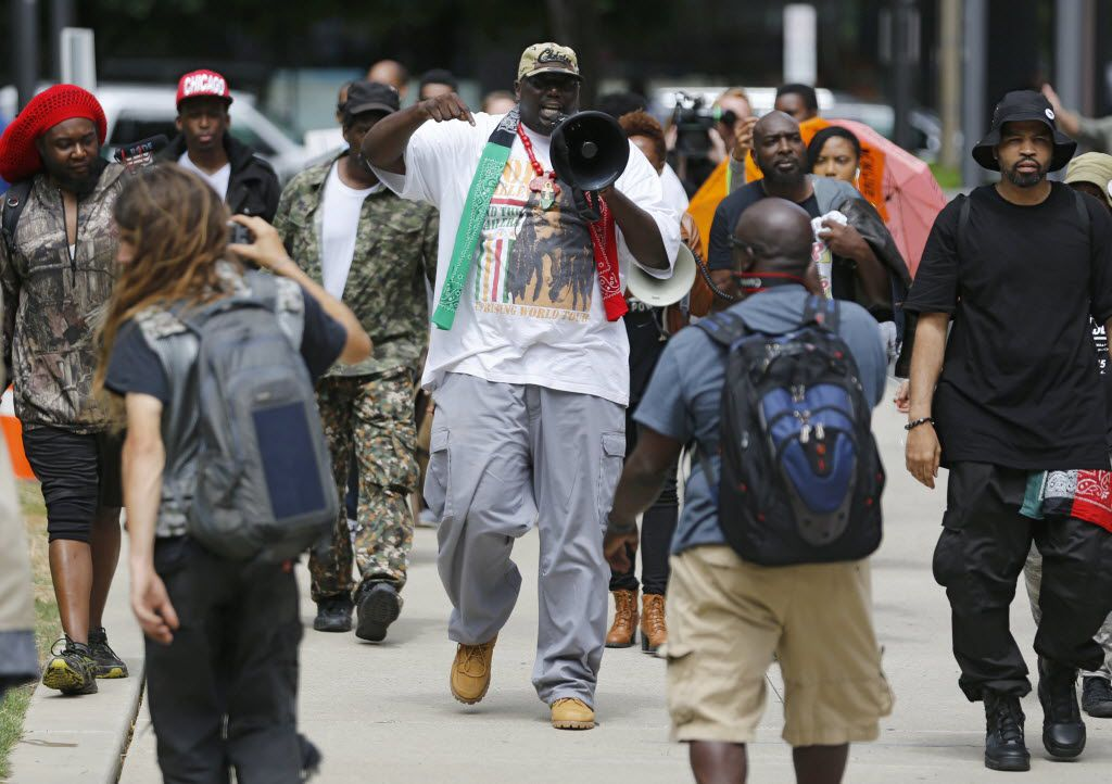 Shakem Akhet of Charleston, South Carolina leads a black unity protest starting in Perk Plaza in Cleveland, Ohio on Saturday, July 16, 2016. The protest is 2 days prior to the start of the Republican National Convention. (Vernon Bryant/The Dallas Morning News)