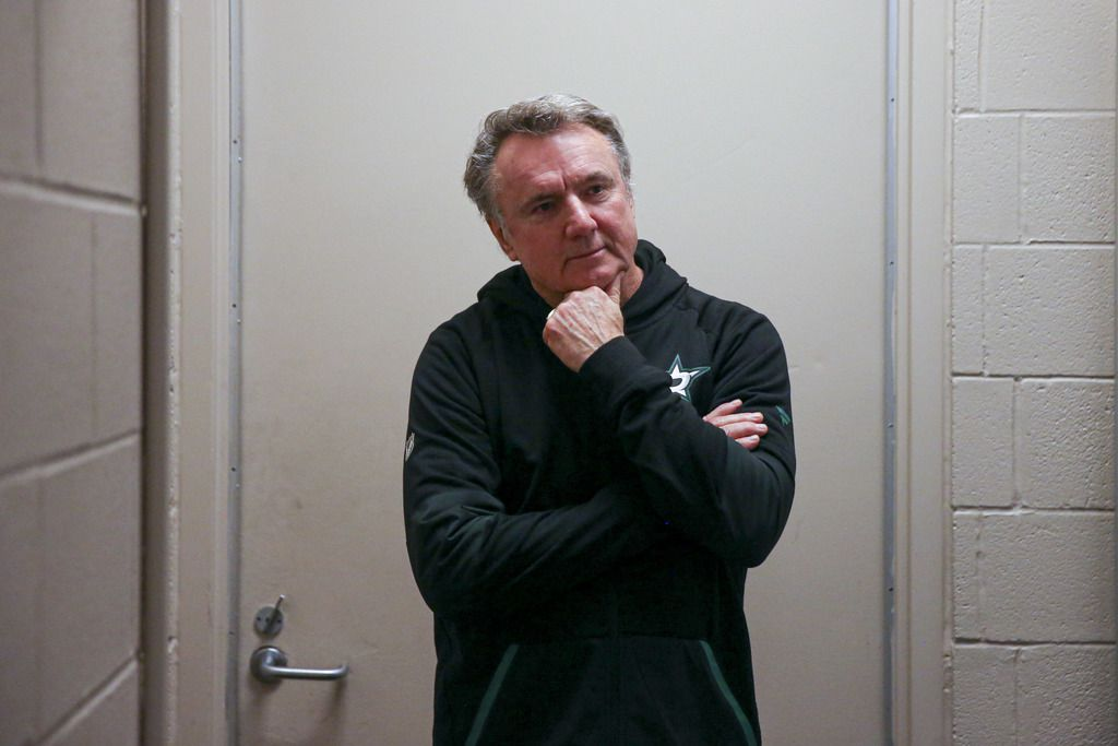 """Dallas Stars Interin head coach Rick Bowness listens as he is announced as the new Dallas Stars interim head coach on Tuesday, December 10, 2019 at American Airline Center in Dallas. On Tuesday Dallas Stars General manager Jim Nill announced that the team had fired head coach Jim Montgomery for """"unprofessional conduct""""."""
