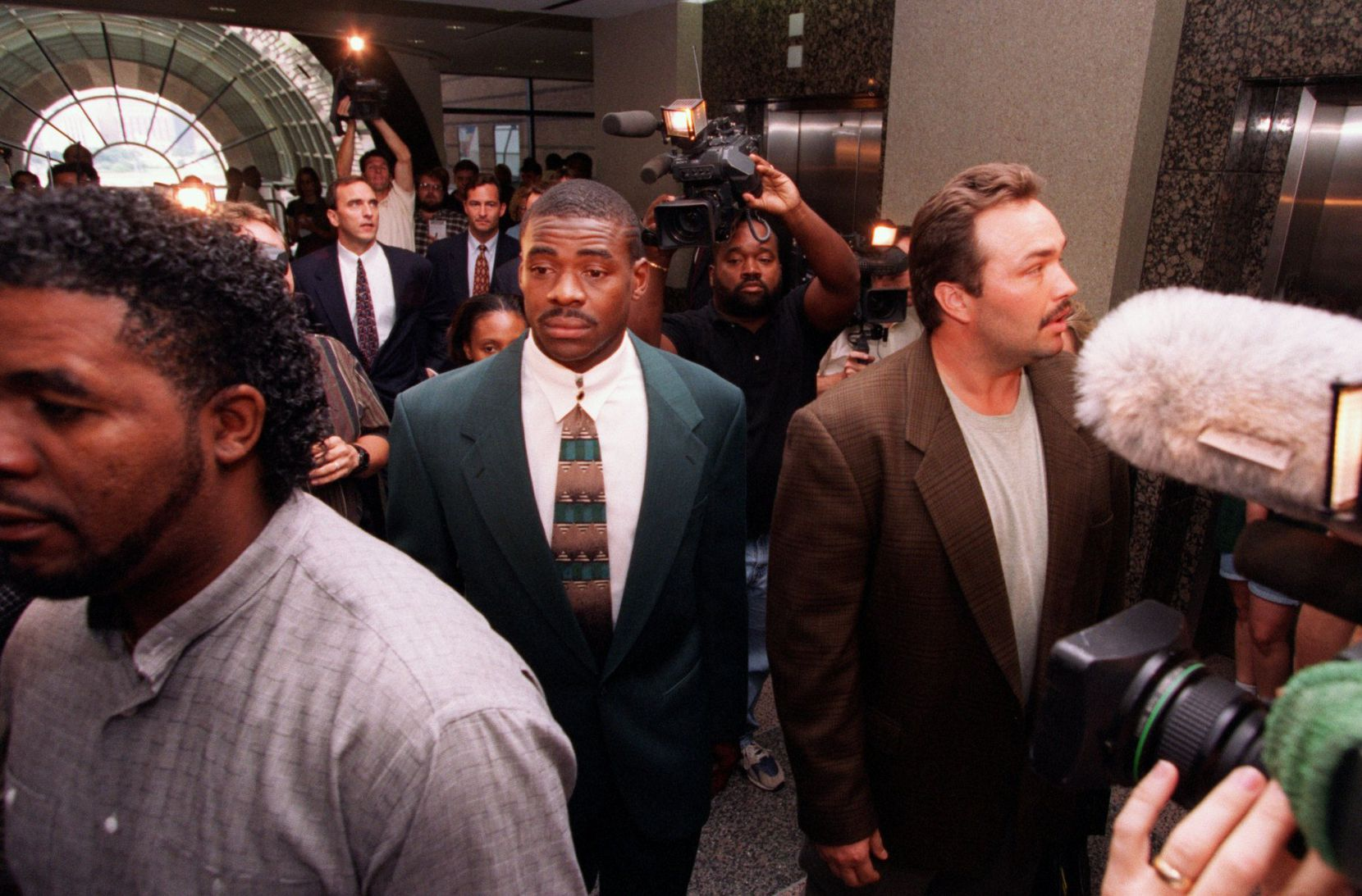 Michael Irvin left the Frank Crowley Courts Building in July 1996 after pleading no contest in his drug trial in Judge Manny Alvarez's courtroom.
