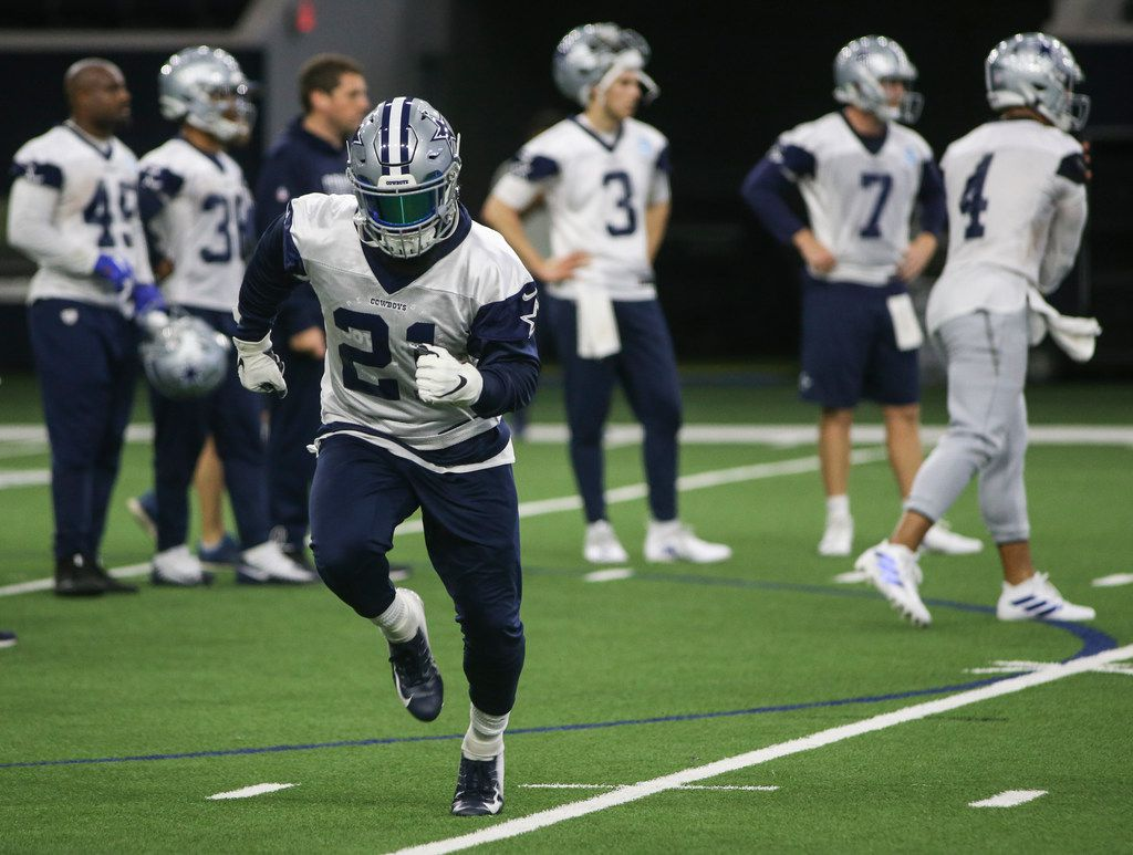 Dallas Cowboys running back Ezekiel Elliott (21) participates in a drill during a Cowboys minicamp practice on Tuesday, June 11, 2019 at The Star in Frisco, Texas. (Ryan Michalesko/The Dallas Morning News)