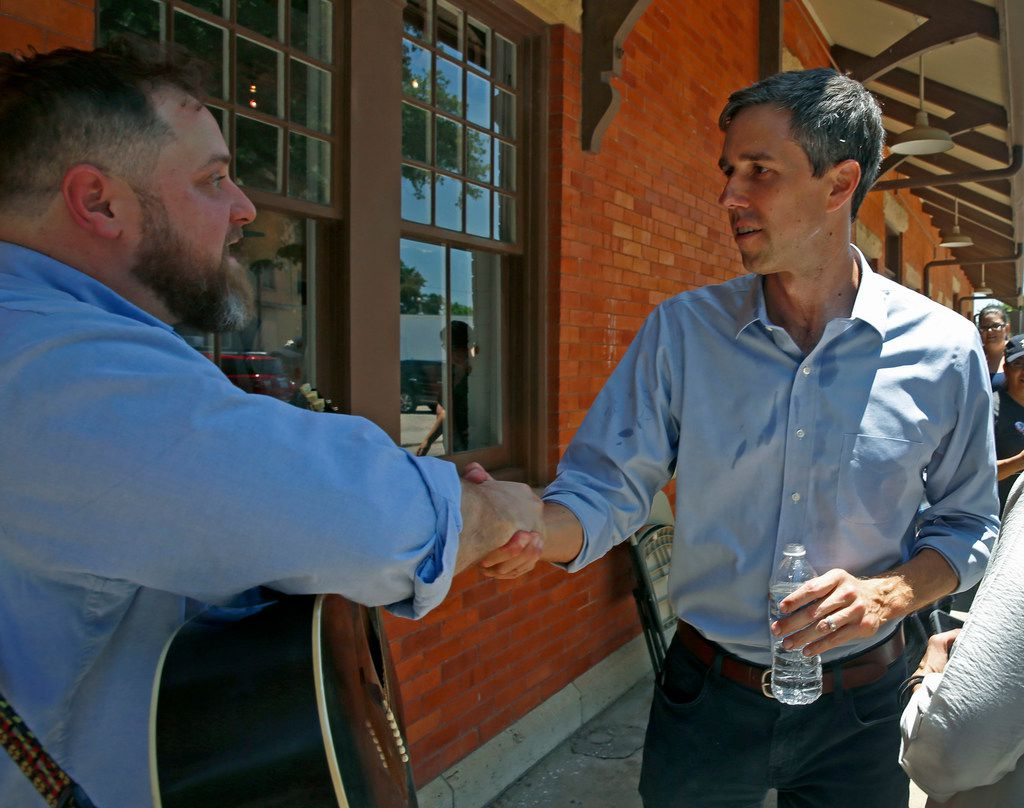 U.S. Rep. Beto O'Rourke, D-El Paso, shakes hands with supporter Isaac Hoskins, who played live music at the Historic Santa Fe Train Depot in Gainesville on Saturday.