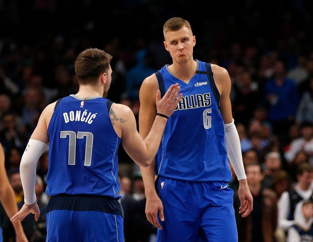 Dallas Mavericks guard Luka Doncic (77) taps Dallas Mavericks forward Kristaps Porzingis (6) after Porzingis makes two free throws in overtime play at American Airlines Center in Dallas on Wednesday, March 4, 2020. Dallas Mavericks defeated the New Orleans Pelicans 127-123. (Vernon Bryant/The Dallas Morning News)