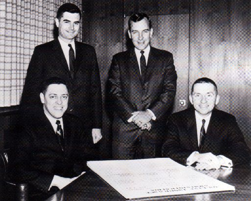 This 1960s photo shows the earliest members of the EDS team (from left): Tom Marquez, Tom Walter, Mitch Hart and Ross Perot.