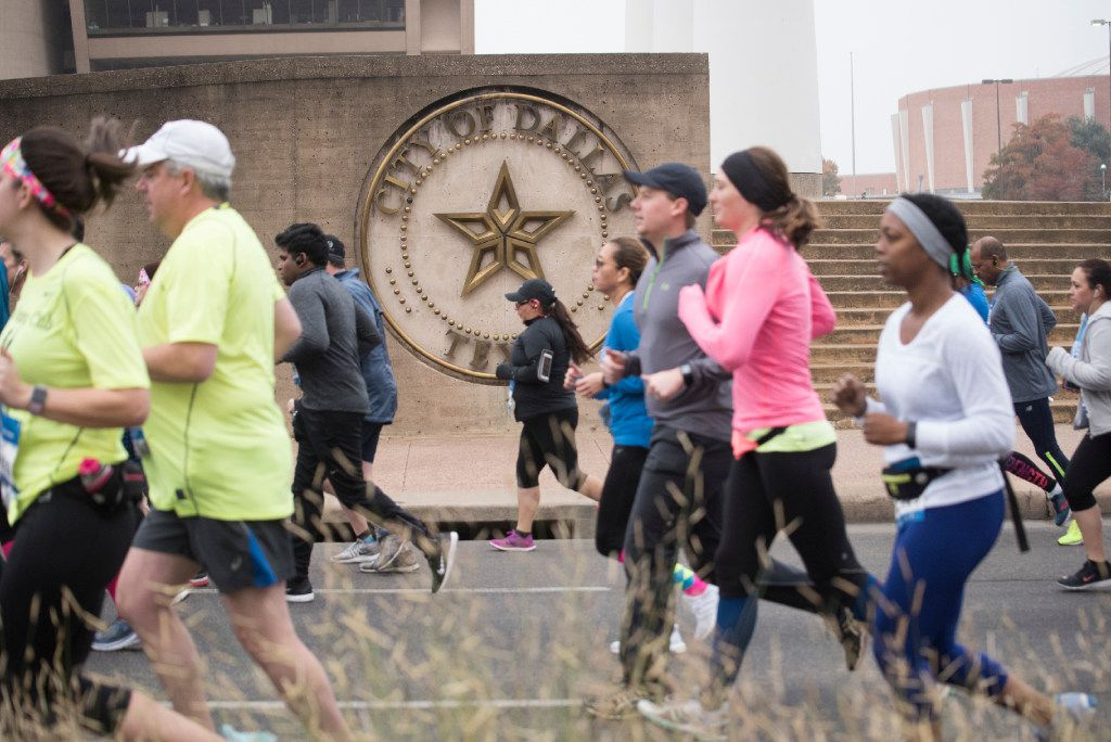 Runners begin the BMW Dallas Marathon and half marathon in 2019. This year's event has been rescheduled for May 2.