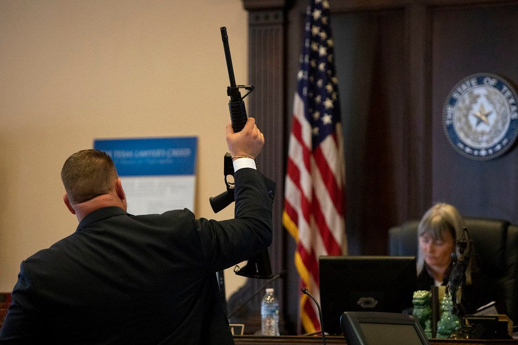 Attorney Jason Webster, an attorney with The Webster Law Firm in Houston, who is representing victims' families, shows a Ruger AR-556 model 8500, the same type of rifle the gunman used to attack First Baptist Church of Sutherland  Springs, to Judge Karen Pozza during a hearing with attorneys for survivors and victim's families and an attorney for Academy Sports + Outdoors, at the Bexar County Courthouse in San Antonio on Thursday, Jan. 31, 2018.