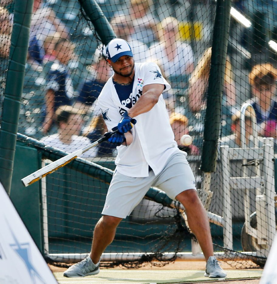 Dallas Cowboys quarterback Dak Prescott (4) swings at the ball during the sixth annual Reliant Home Run Derby at Dr Pepper Ballpark in Frisco on Monday, May 8, 2017. Proceeds from the event benefited The Salvation Army Greater Metroplex Command. (Vernon Bryant/The Dallas Morning News)
