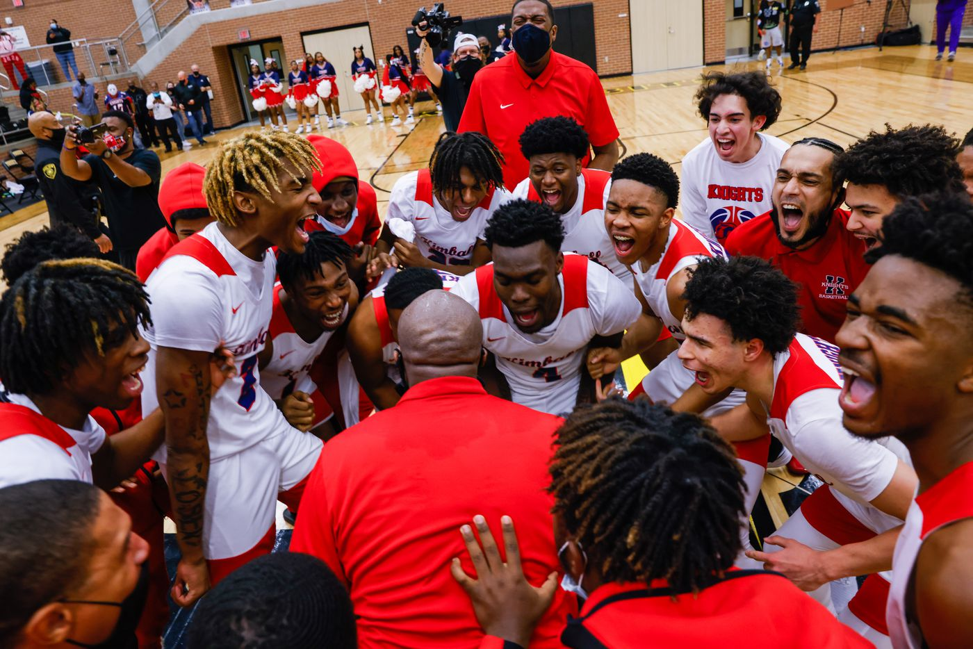 Kimball celebrates their win over Lancaster following overtime of a boys basketball UIL Class 5A Region II playoff game in Forney on Friday, March 5, 2021. (Juan Figueroa/ The Dallas Morning News)