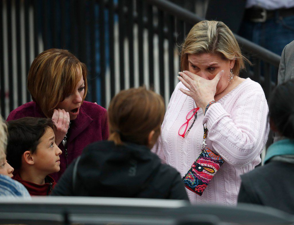 Parents fought back tears as they waited for their children at a recreation center where students were reunited with their parents Tuesday, May 7, 2019, in Highlands Ranch, Colo..