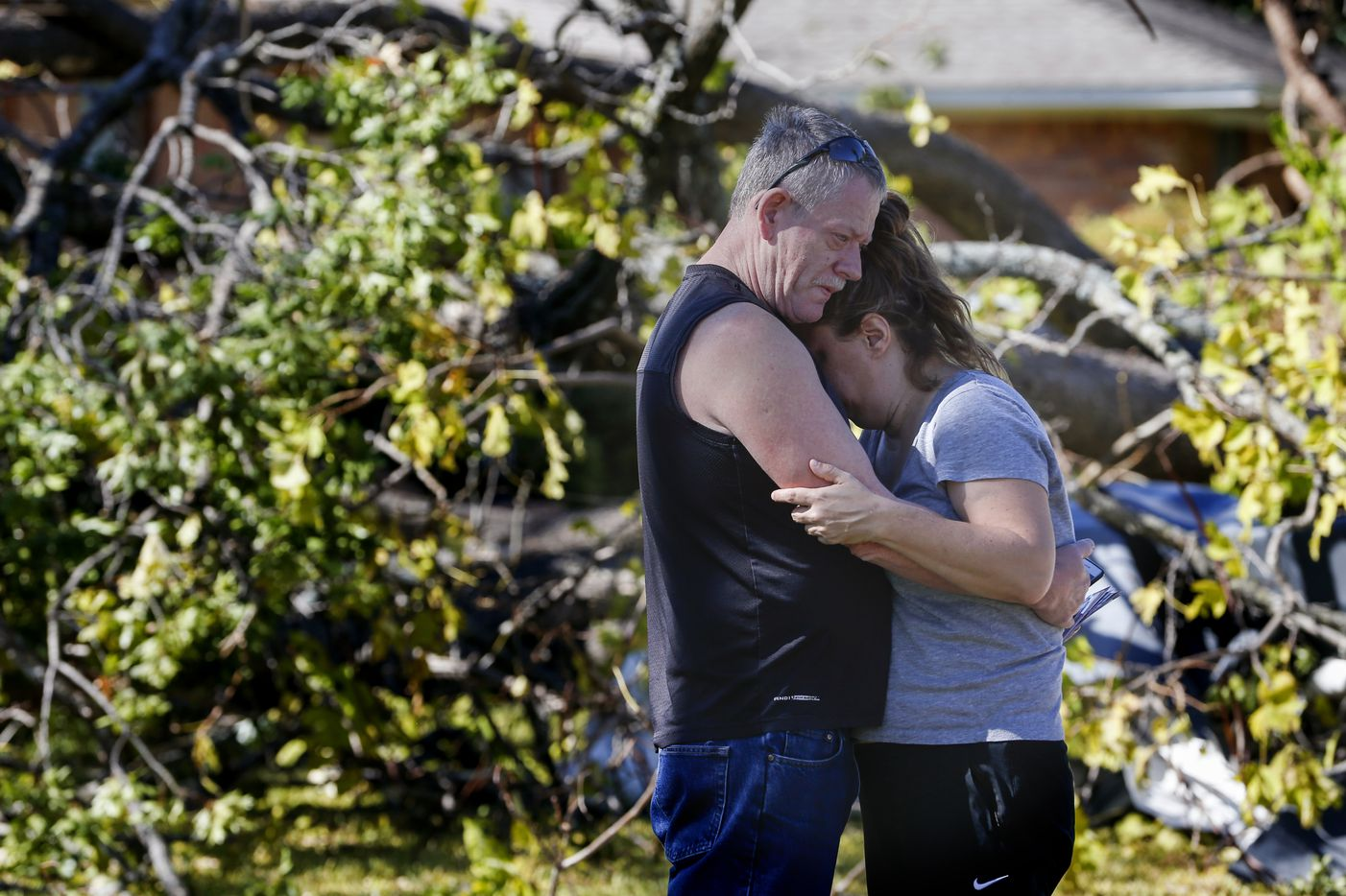 Tommy Edmonds, left, embraces his wife, Heidi Edmonds outside of their home, which was destroyed when a tornado hit the night before, on Westway Avenue in Garland, Texas, on Sunday, Oct. 21, 2019.