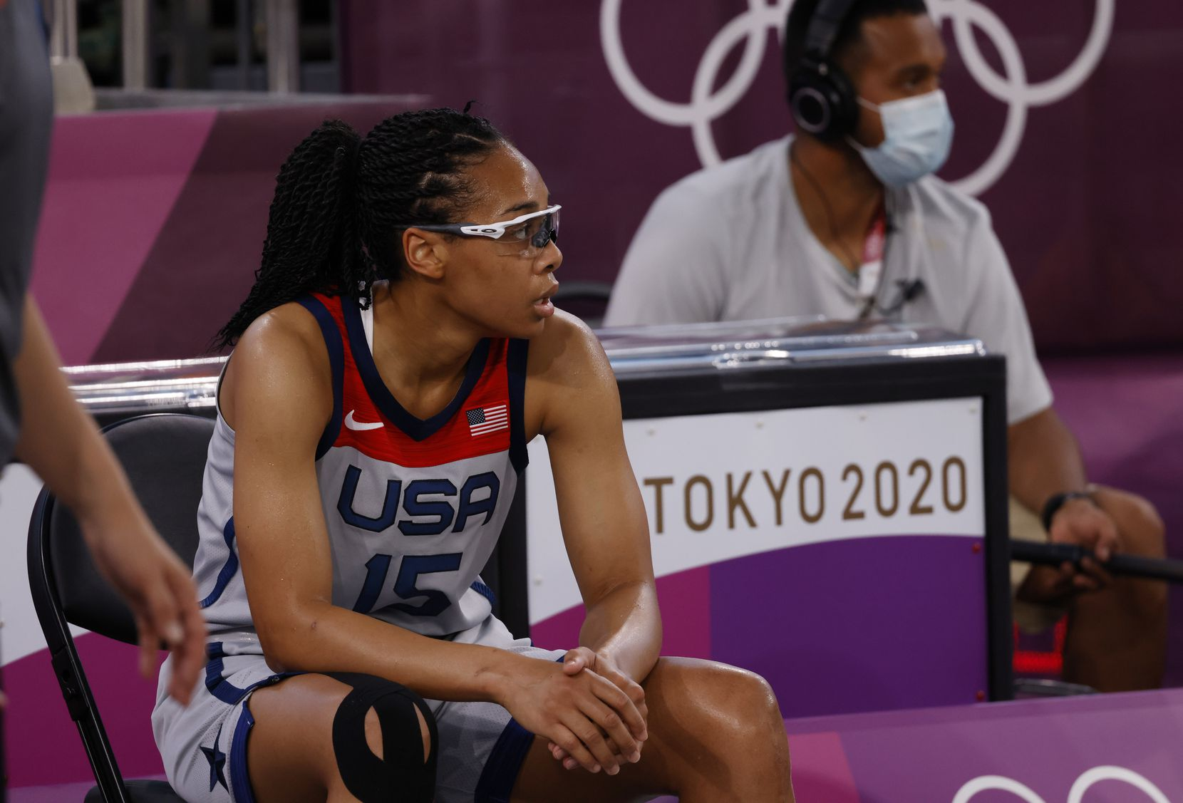 USA's Allisha Gray (15) takes a breather in a game against France during a 3x3 women's basketball game during the postponed 2020 Tokyo Olympics at Aomi Urban Sports Park on Saturday, July 24, 2021, in Tokyo, Japan. USA defeated France 17-10 in the game. (Vernon Bryant/The Dallas Morning News)