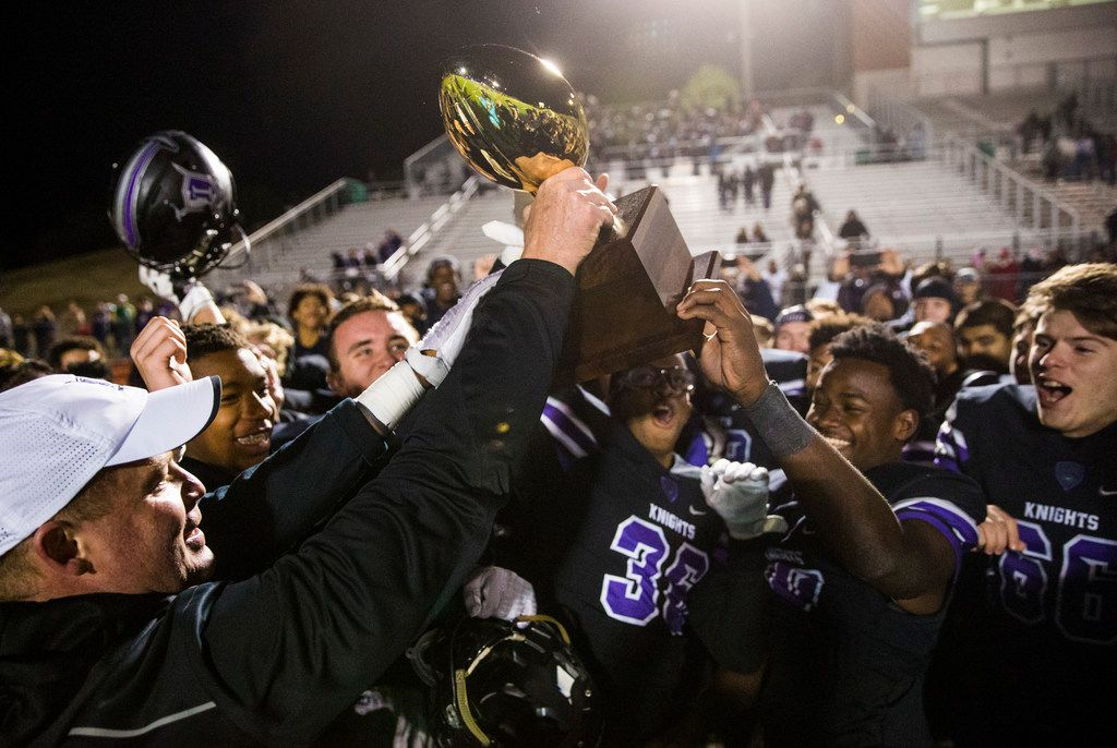 Frisco Independence football players react to receiving the bi-district championship trophy after a UIL Class 5A Division I first-round playoff football game between Mansfield Timberview and Frisco Independence on Thursday, November 14, 2019 at Frisco ISD Memorial Stadium in Frisco. Frisco Independence won 43-28. (Ashley Landis/The Dallas Morning News)