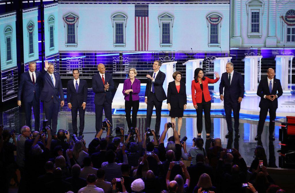 From left: Democratic presidential candidates New York City Mayor Bill De Blasio; U.S. Rep. Tim Ryan of Ohio; former housing secretary Julian Castro of San Antonio; U.S. Sen. Cory Booker of New Jersey; U.S. Sen. Elizabeth Warren of Massachusetts; former U.S. Rep. Beto O'Rourke of El Paso; U.S. Sen. Amy Klobuchar  of Minnesota; U.S. Rep. Tulsi Gabbard of Hawaii;, Washington Gov. Jay Inslee; and former Maryland Congressman John Delaney take the stage during the first night of the Democratic presidential debate on June 26, 2019, in Miami.