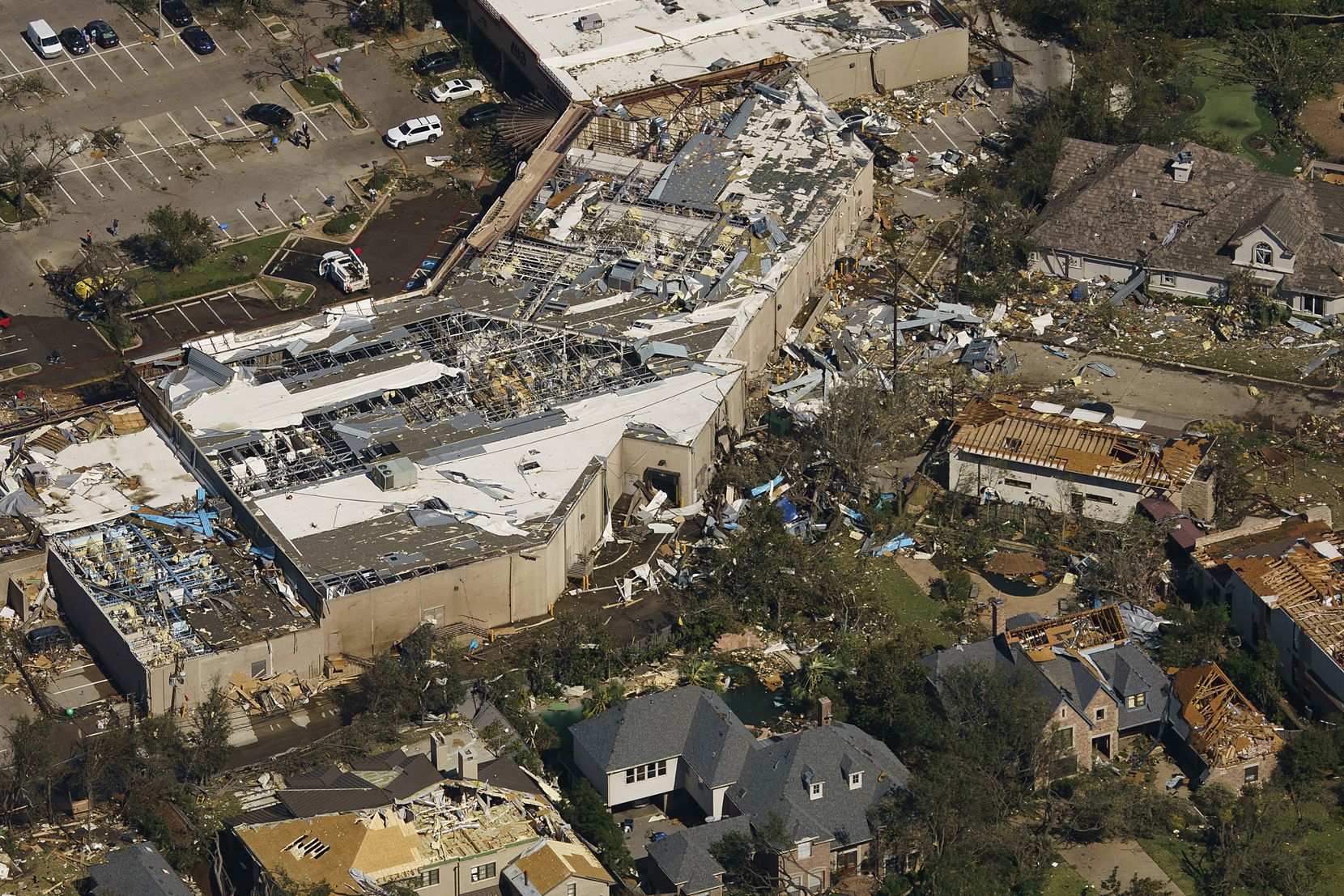 Damage is seen to the Preston Royal shopping center and neighboring homes in an aerial view of the tornado's aftermath on Monday, Oct. 21, 2019, in Dallas.