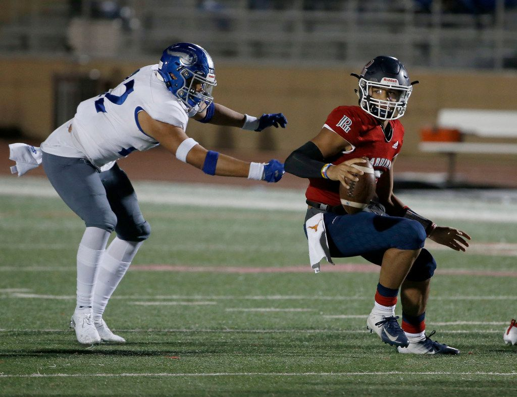 John Paul II quarterback  Grayson James, right, gets away from Nolan defender Frankie Romero (22) during the first half of their TAPPS Division I second-round high school football playoff game in Grapevine, Tx, Friday, Nov. 22, 2019. (Michael Ainsworth)