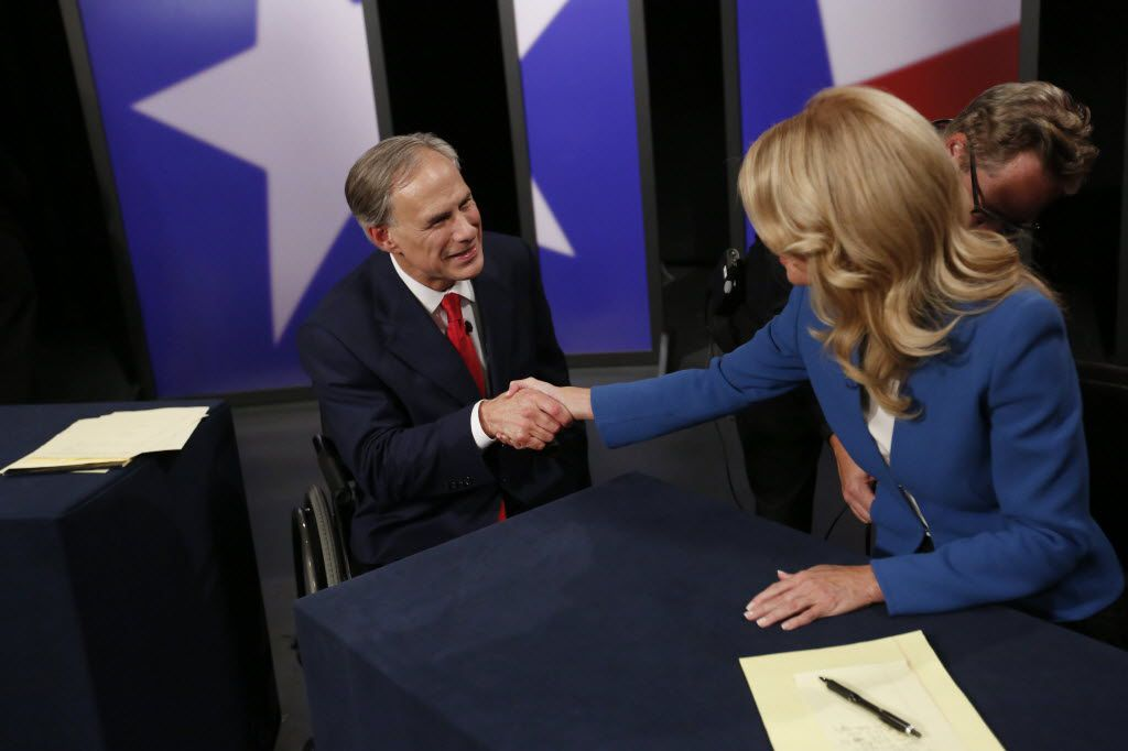 Before their final gubernatorial debate in 2014, Texas Attorney General Greg Abbott and state Sen. Wendy Davis shook hands.