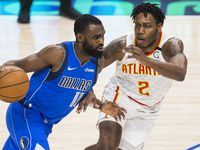 Dallas Mavericks guard Tim Hardaway Jr. (11) drives past /a2/ during the fourth quarter of an NBA game between the Dallas Mavericks and the Atlanta Hawks on Saturday, February 1, 2020 at American Airlines Center in Dallas.