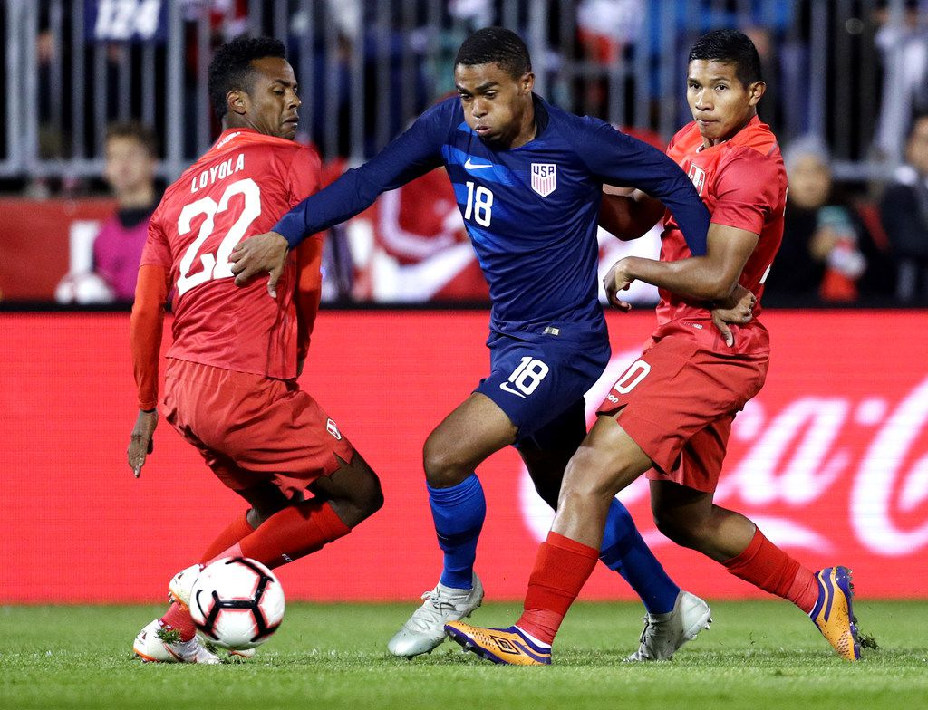EAST HARTFORD, CT - OCTOBER 16: Nilson Loyola #22 of Peru defends Reggie Cannon #18 of the United States during their game at Rentschler Field on October 16, 2018 in East Hartford, Connecticut.(Photo by Maddie Meyer/Getty Images)