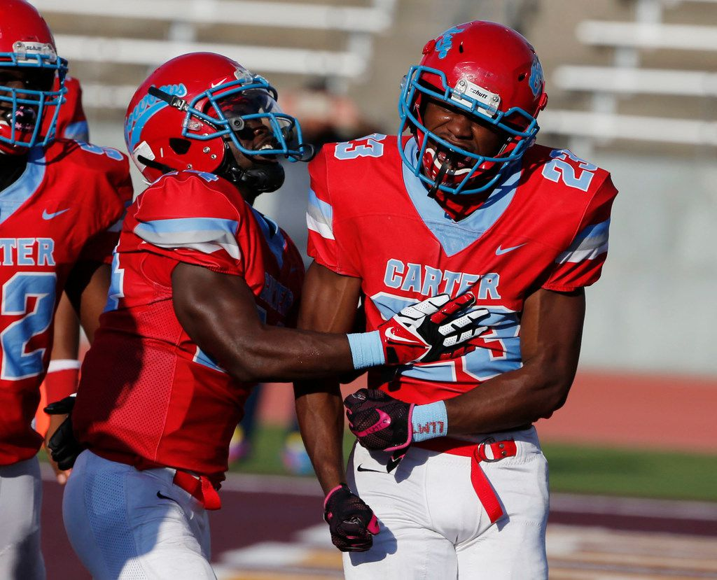 Dallas Carter's Jamalrian Jones (23) celebrates his rushing touchdown with Jaquallin Evans (left) against Houston Yates during the first half of their high school football game in Dallas, Texas on August 31, 2019. (Michael Ainsworth/Special Contributor)