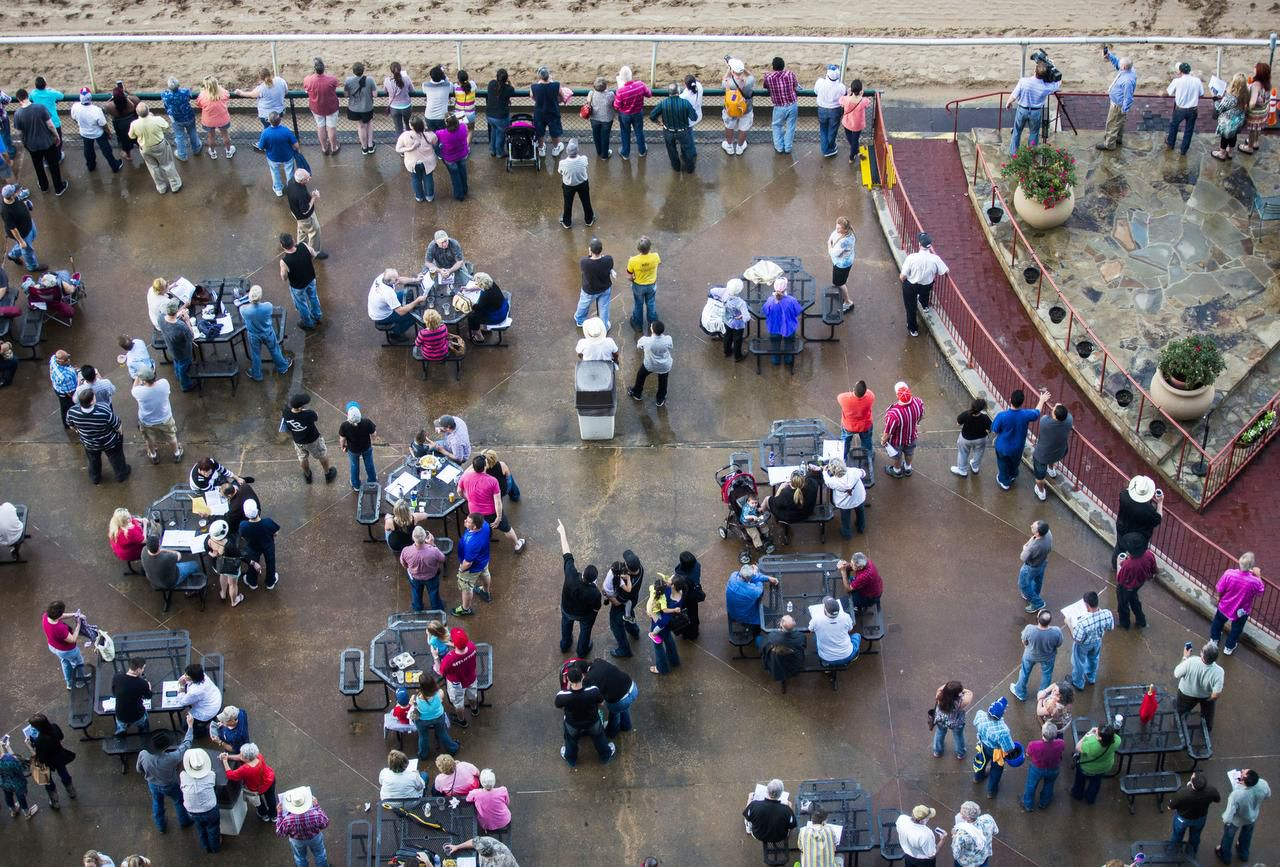 A good crowd was on hand for Thursday's opening night at Lone Star Park in Grand Prairie, though weather concerns may have kept others from coming out to the track.