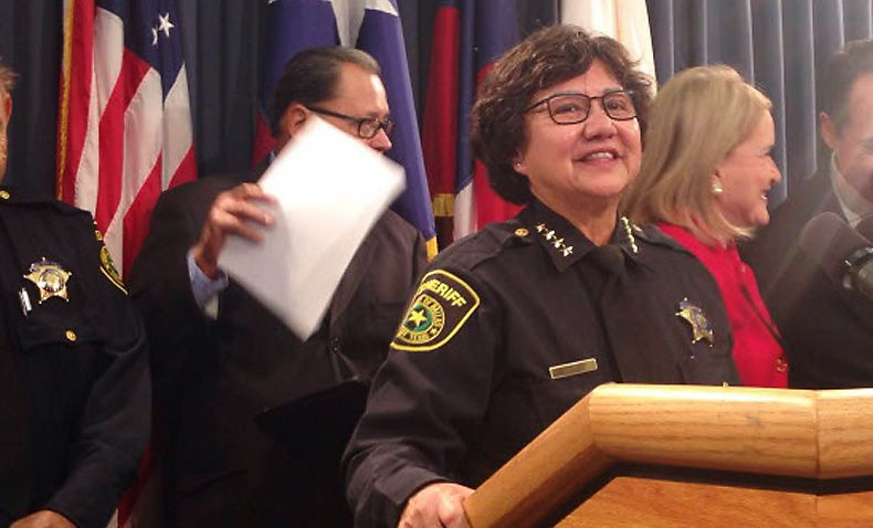 """Dallas County Sheriff Lupe Valdez speaks at a Dec. 3 press conference in Austin about possible """"sanctuary cities"""" legislation. Two lawsuits have been filed by Dallas County Jail inmates against Valdez and the county over """"immigration holds."""" (Tom Benning/Staff)"""