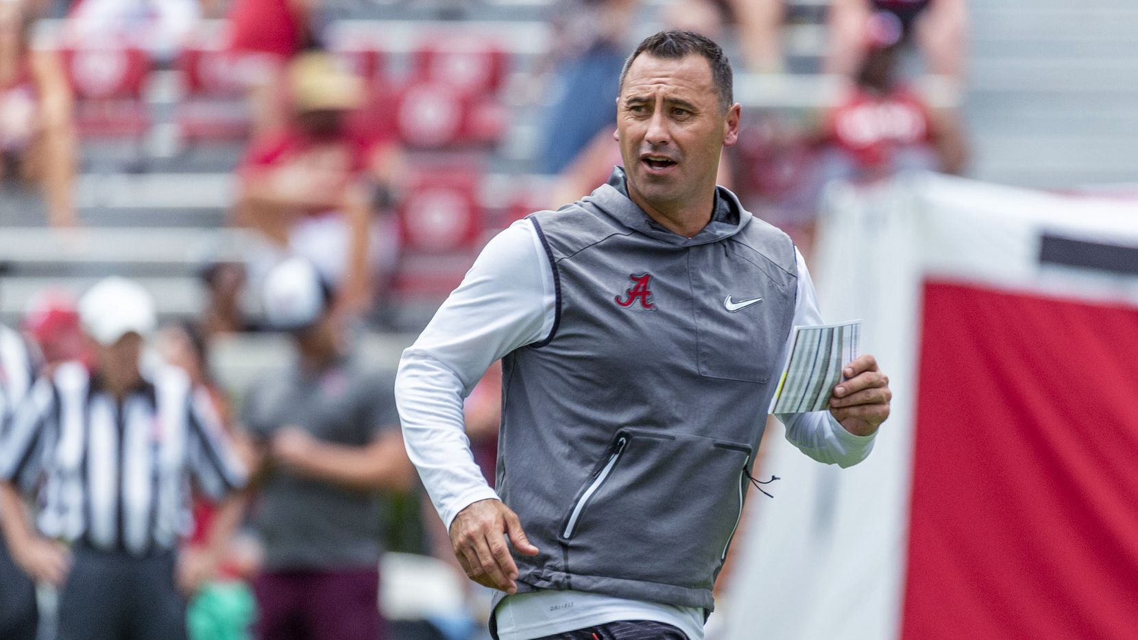 Alabama offensive coordinator Steve Sarkisian works his payers through drills during an NCAA college fall camp fan-day college football scrimmage, Saturday, Aug. 3, 2019, at Bryant-Denny Stadium in Tuscaloosa, Ala. (AP Photo/Vasha Hunt)