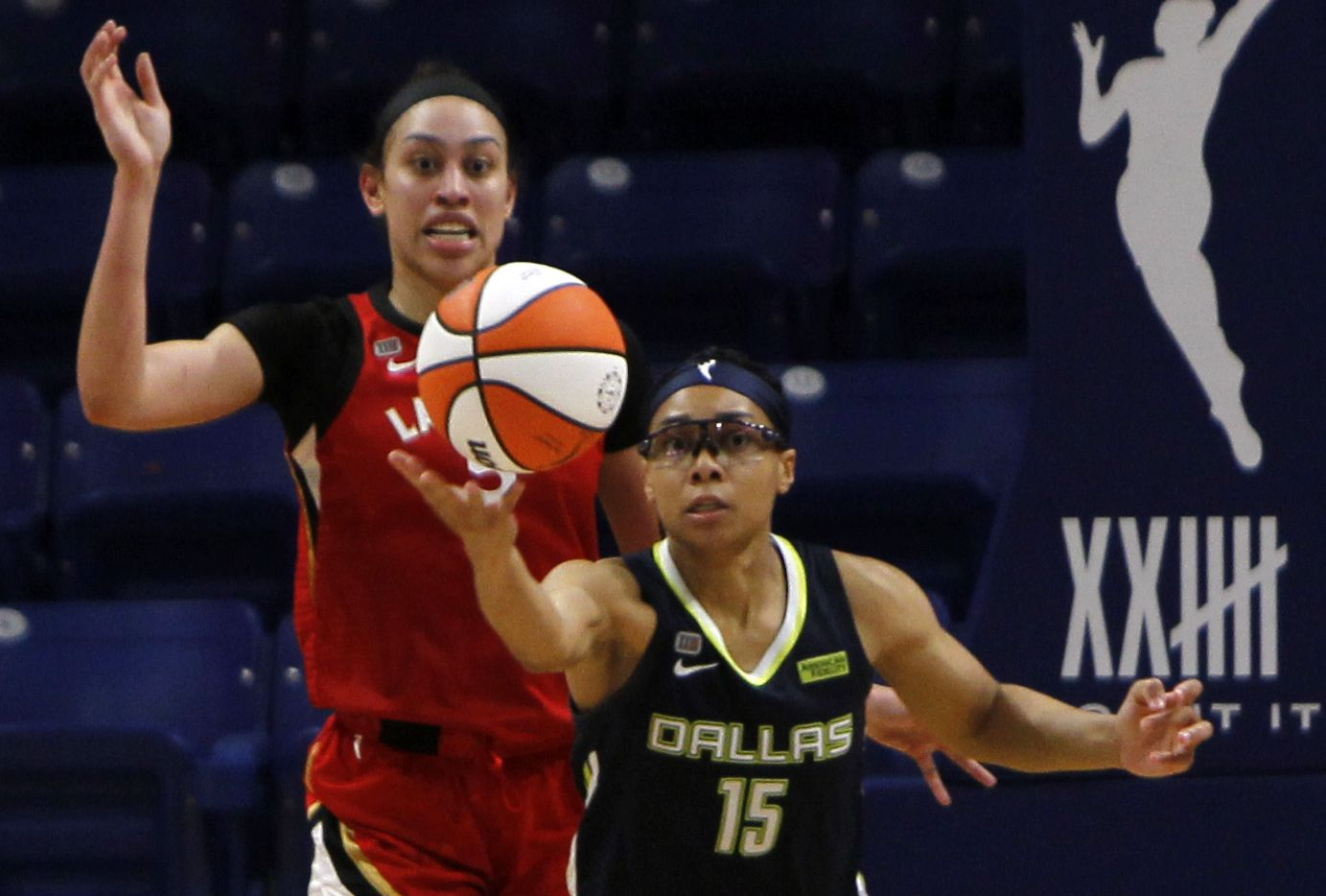 Dallas Wings guard Allisha Gray (15) reaches for a rebound as Las Vegas forward Dearica Hamby (5) looks on during first half action. Las Vegas defeated Dallas 95-79. The two WNBA teams played their game at College Park Center on the campus of UT-Arlington on July 11, 2021.