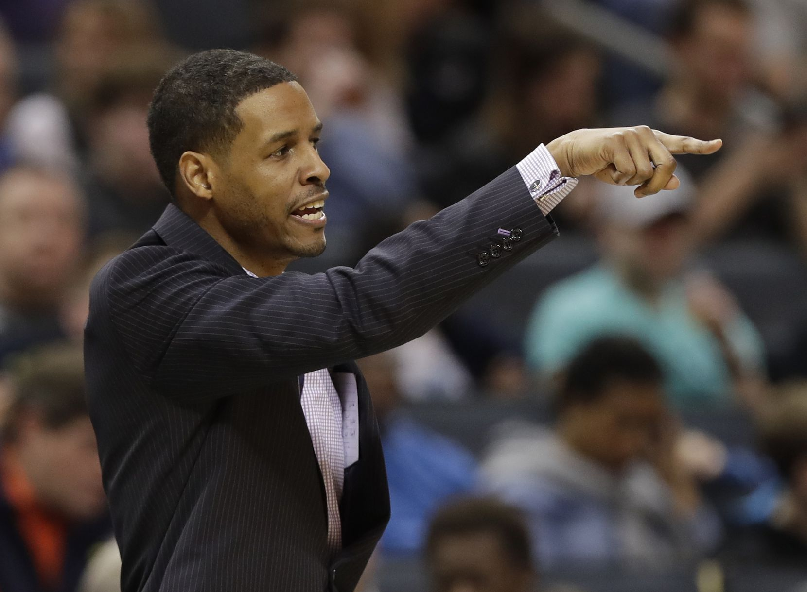 Charlotte Hornets associate head coach Stephen Silas directs his team against the Utah Jazz during the first half of an NBA basketball game in Charlotte, N.C., Friday, Jan. 12, 2018. (AP Photo/Chuck Burton)