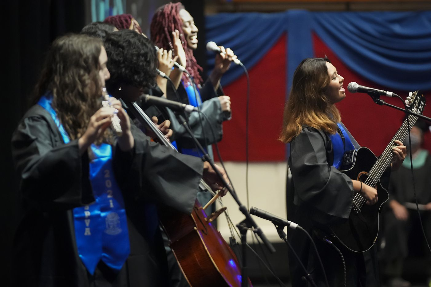 Members of the Music Conservatory perform during commencement ceremonies for Booker T. Washington HSPVA at Loos Field House on Saturday, June 19, 2021.