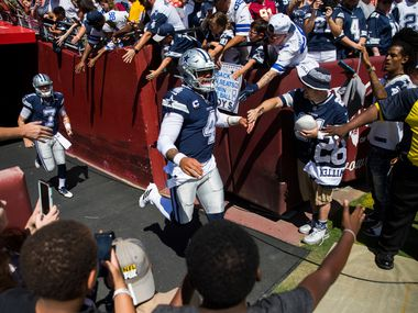 Dallas Cowboys quarterback Dak Prescott (4) enters the field to warm up before an NFL game between the Dallas Cowboys and the Washington Redskins on Sunday, September 15, 2019 at FedExField in Landover, Maryland.