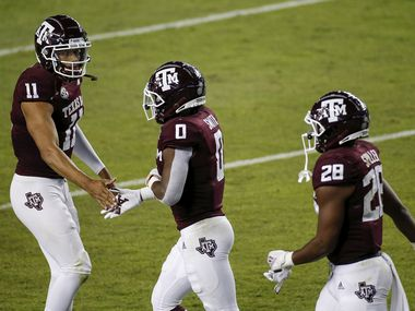 COLLEGE STATION, TEXAS - OCTOBER 31: Kellen Mond #11 of the Texas A&M Aggies congratulates Ainias Smith #0 after a touchdown in the first quarter against the Arkansas Razorbacks at Kyle Field on October 31, 2020 in College Station, Texas.