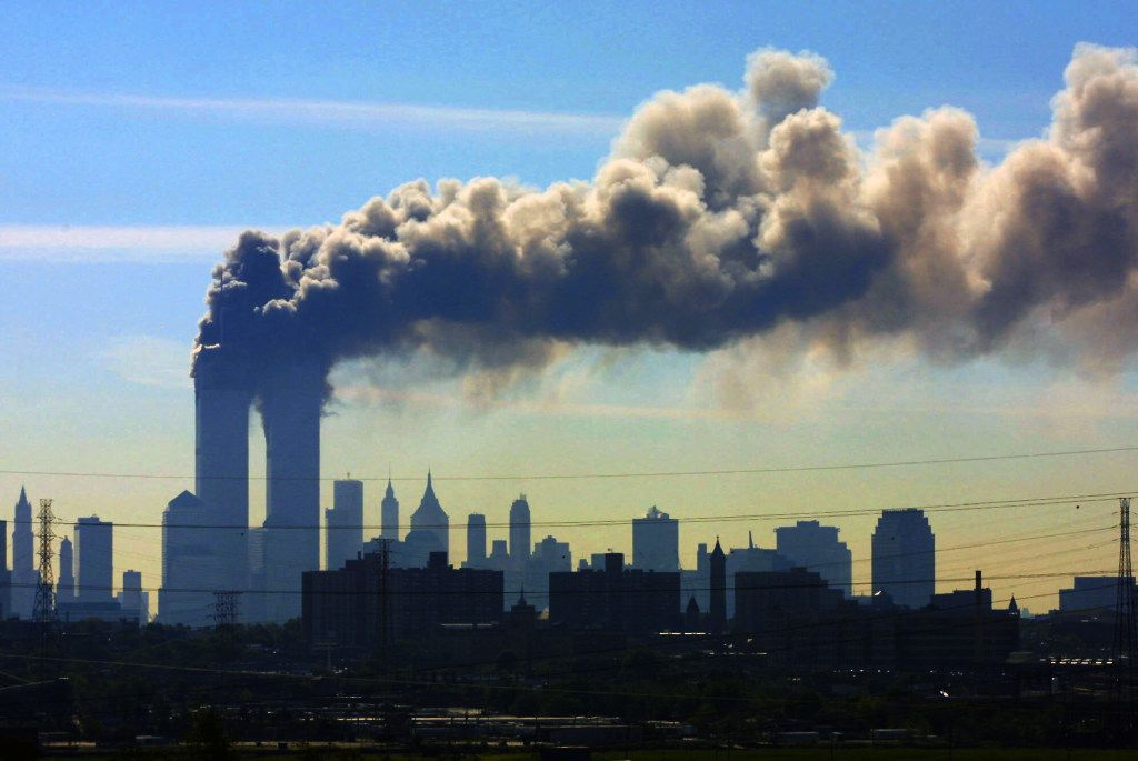 In this Sept. 11, 2001 file photo, as seen from the New Jersey Turnpike near Kearny, N.J., smoke billows from the twin towers of the World Trade Center in New York after airplanes crashed into both towers. Saudi Arabia and its allies are warning that legislation allowing the kingdom to be sued for the 9/11 attacks will have negative repercussions.  (File Photo/The Associated Press)