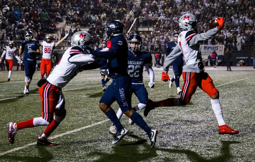 Flower Mound Marcus wide receiver J. Michael Sturdivant (7) runs to the end zone for a touchdown during the second quarter of a District 6-6A high school football game between Flower Mound Marcus and Flower Mound on Friday, October 25, 2019 at Neil E. Wilson Stadium in Flower Mound.