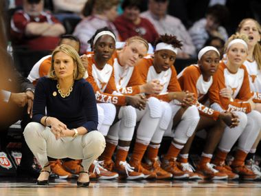 FILE - Texas Longhorns head coach Karen Aston watches her team in action against the Kansas Jayhawks in the fourth quarter during the women's Big 12 conference tournament at Chesapeake Energy Arena in Oklahoma City on March 5, 2016.