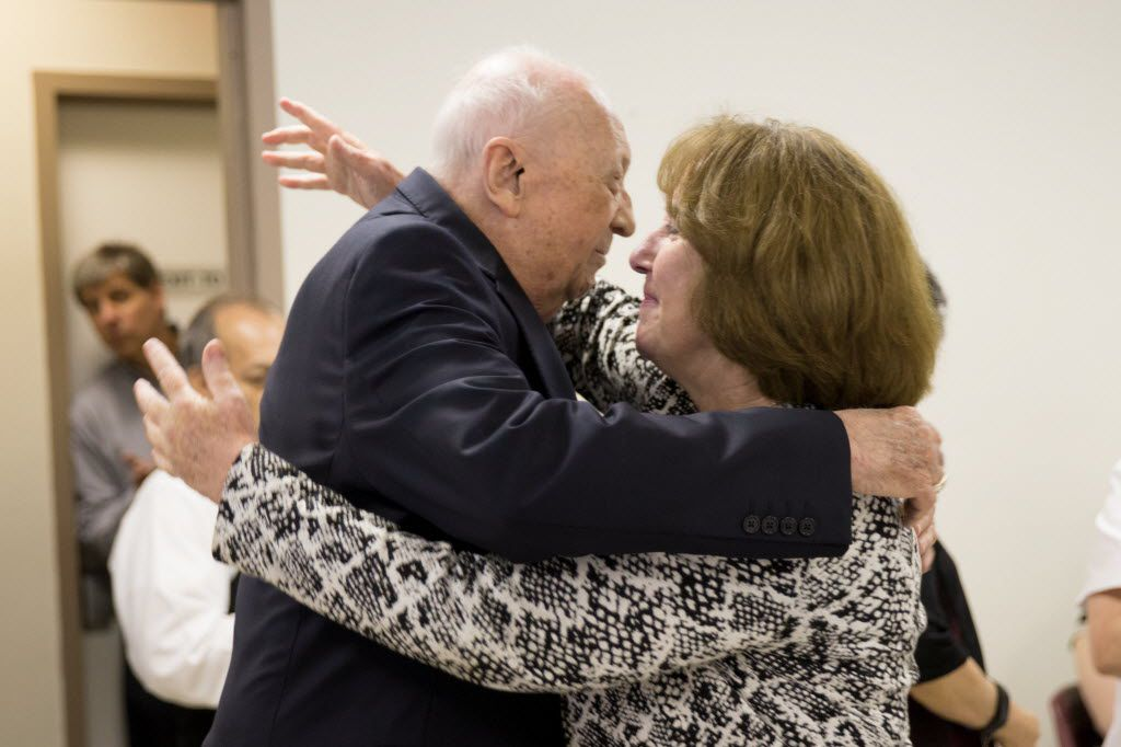Steven Landregan embraces Mary Edlund, chancellor of the Dallas Diocese, during the retirement party for  Landregan and Tony Ramirez at the Diocese of Dallas Pastoral Center on June 23, 2016.